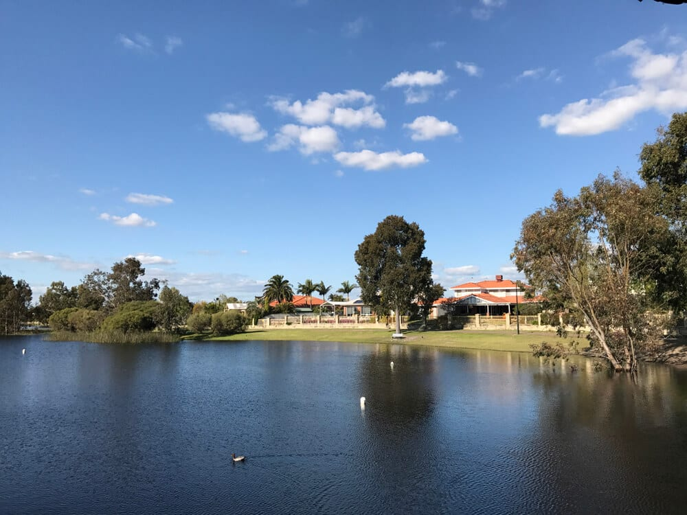 A picture of houses overlooking a lake in Perth