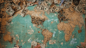 A world map with money on it to hightight transferring money to Australia