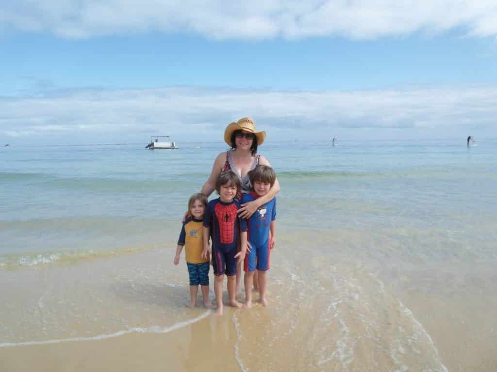 A family on the beach at Tangalooma Island Resort