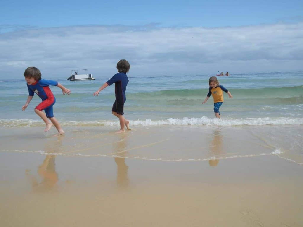 Kids playing in the water at Tangalooma Island