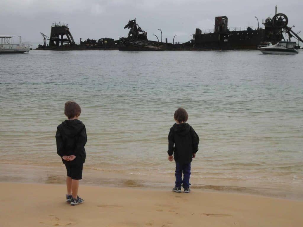 Two boys looking at the Tangalooma Wrecks at Tangalooma Island