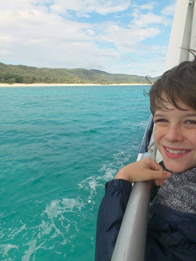 A boy on a Brisbane whale watching cruise