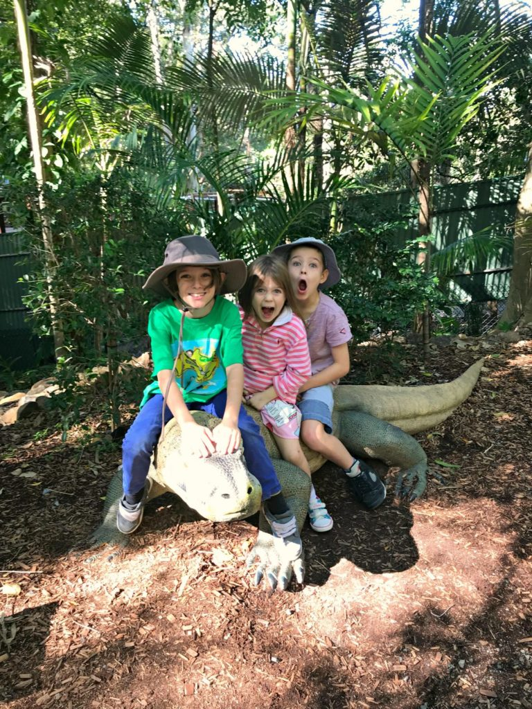 Three kids and a dinosaur at Currumbin Wildlife Sanctuary on the Gold Coast