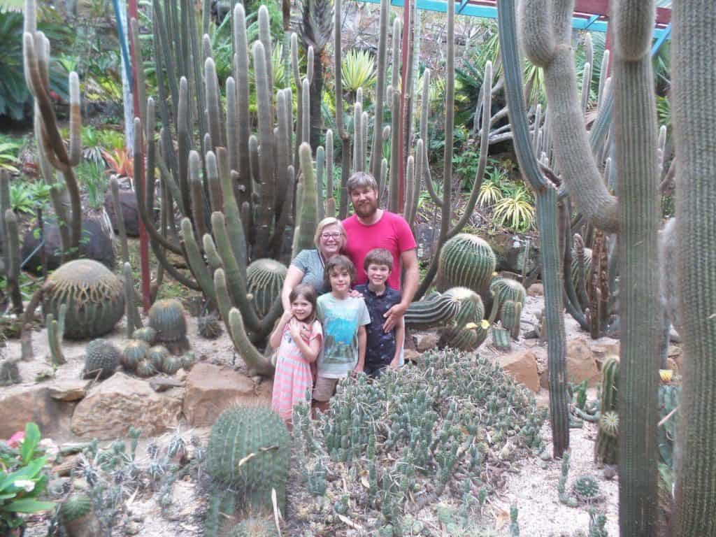 Karen Bleakley and her family surrounded by cactus plants