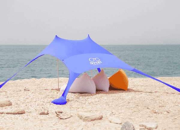 A blue Chillout beach shade tent on the sand