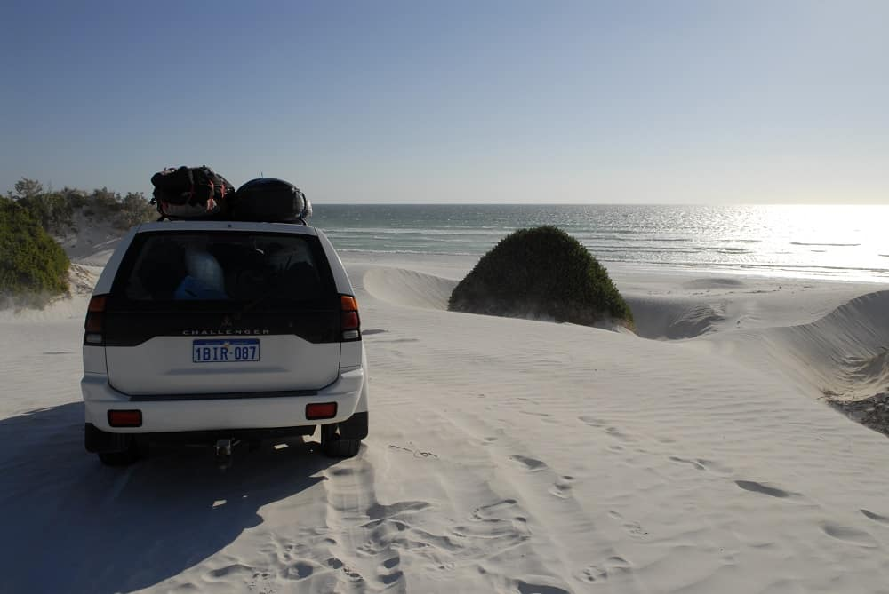 A 4wd car on a beach in Australia