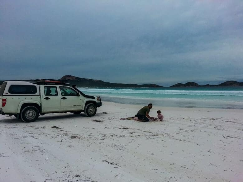 A family who've been beach driving in Australia