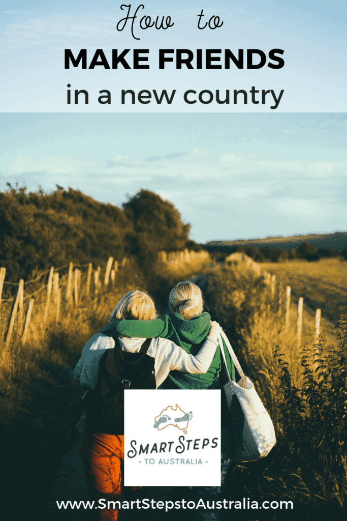 Pinterest image for how to make friends in a new country showing two friends in the countryside