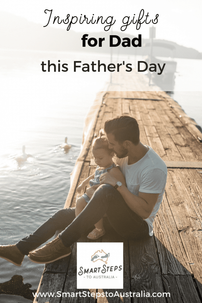 Pinterest image of a day and daughter on a jetty promoting the best gifts for dads on Father's Day