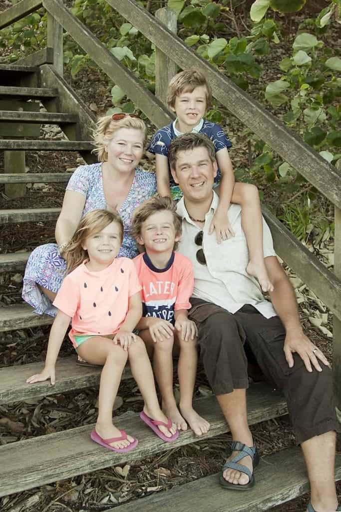 A picture of Karen Bleakley and her family sitting on some steps