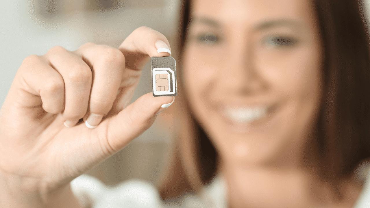A lady holding an Australia sim card