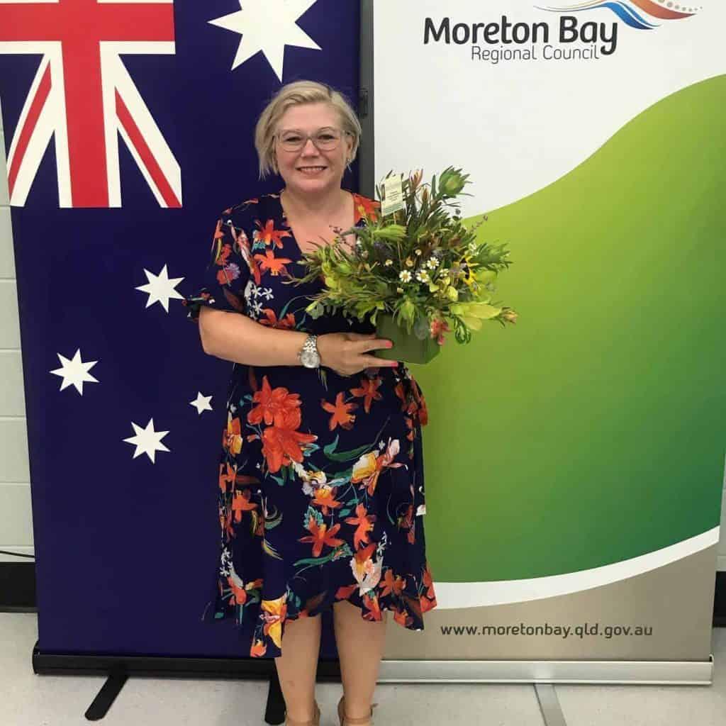 Karen Bleakley receiving their Australian citizenship certificates at the Australian citizenship ceremony