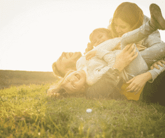 A family on the grass laughing