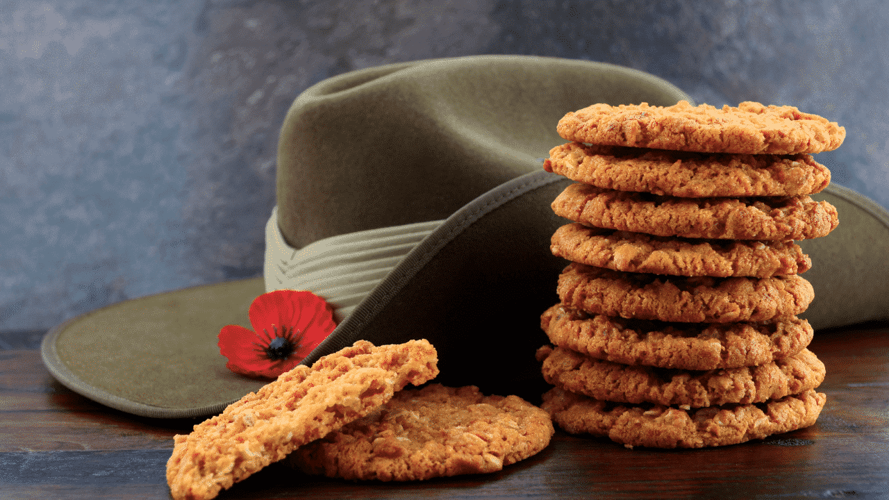 A stack of Anzac biscuit snacks in Australia with a hat and poppy