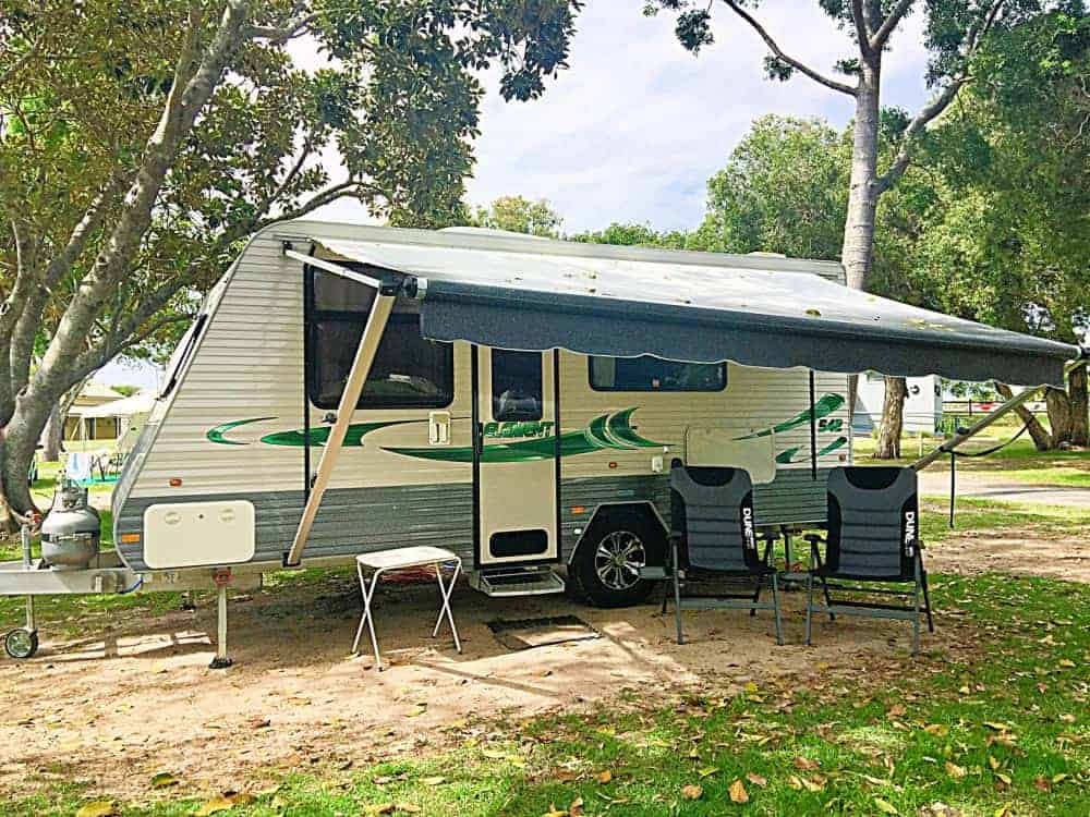 A caravan set up with camping gear essentials in Australia