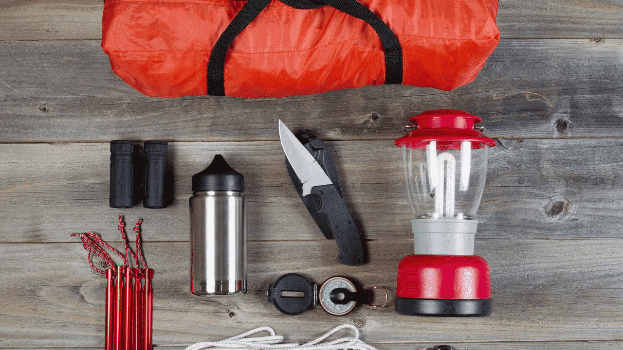Essential camping gear laid out in a flat lay