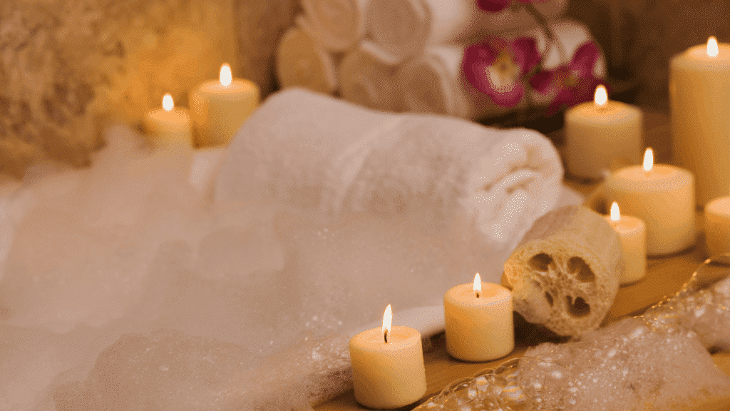 A bath and candles ready for a self care routine