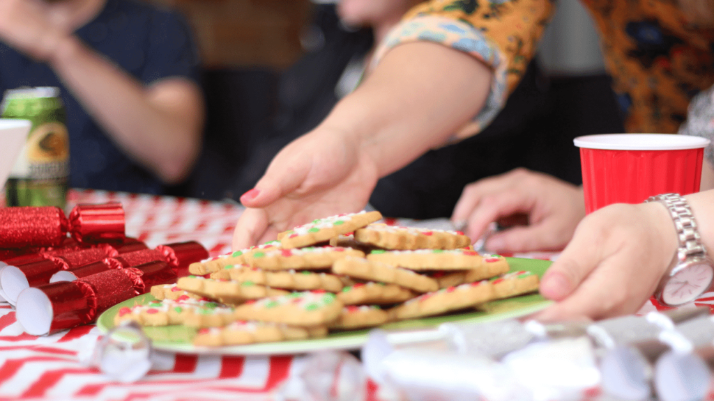 Someone holding a plate of Christmas cookies in Australia