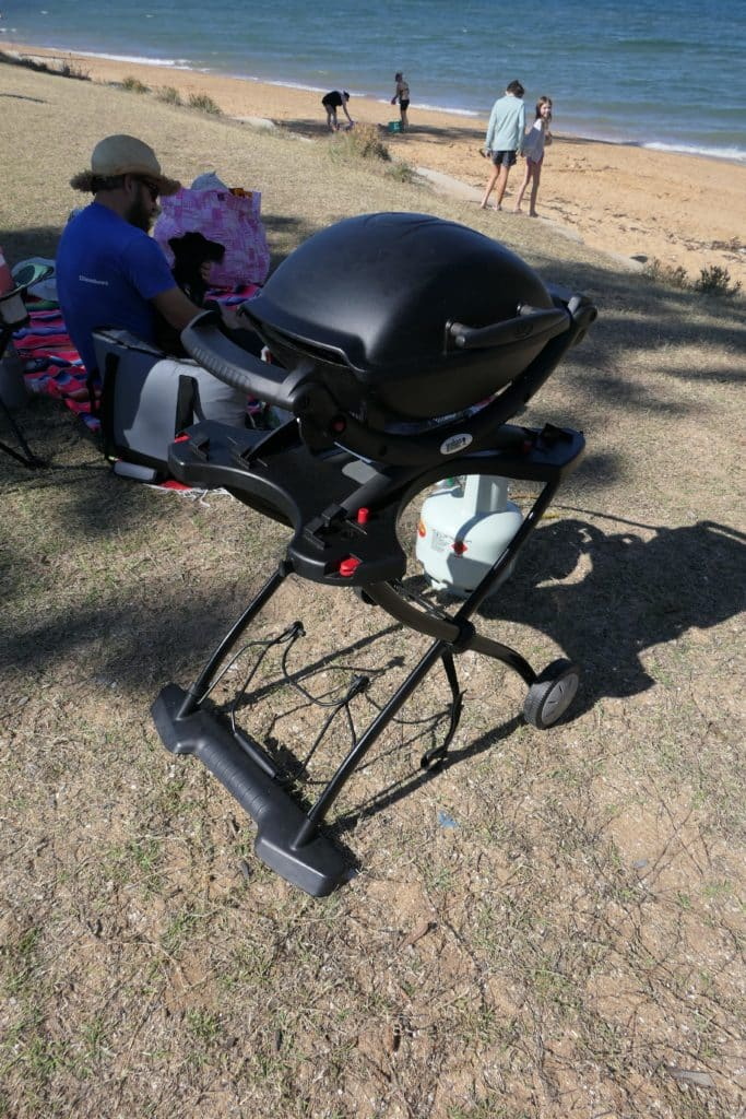 A Weber Baby Q BBQ set up ready to cook outside